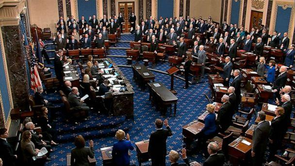 PHOTO: Presiding officer Supreme Court Chief Justice John Roberts swears in members of the Senate for the impeachment trial against President Donald Trump at the U.S. Capitol in Washington, Jan. 16, 2020. (Senate Television via AP)