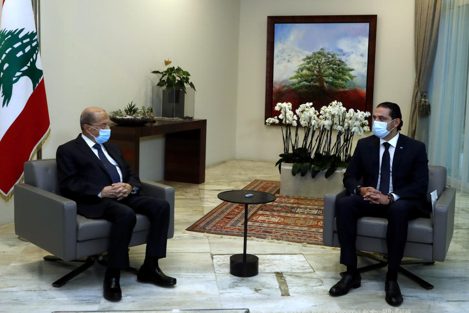 FILE - In this file photo released Monday, March. 22, 2021 by the Lebanese government, Lebanese President Michel Aoun, left, meets with Lebanese Prime Minister-Designate Saad Hariri, at the presidential palace, in Baabda, east of Beirut, Lebanon. Lebanon's president and prime minister exchanged accusations of obstruction, negligence and insolence Wednesday, June 2, 2021, escalating a war or words that has obstructed formation of a government in the crisis-hit country and snubbing mediation efforts that seek to break a months-long deadlock. (Dalati Nohra/Lebanese Official Government via AP, File)