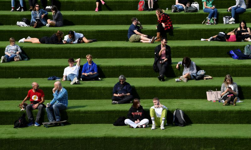 """People are seen relaxing in an outdoor seating area, whilst the reproduction """"R"""" number of COVID-19 infections in the United Kingdom has risen and may be above 1, London, Britain"""