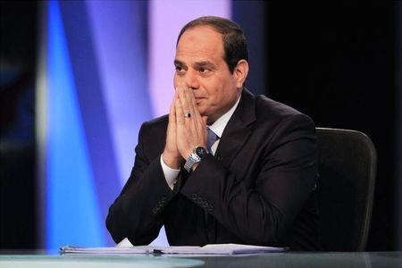 Presidential candidate and Egypt's former army chief Abdel Fattah al-Sisi talks during a television interview broadcast on CBC and ONTV, in Cairo, May 6, 2014. REUTERS/Al Youm Al Saabi Newspaper