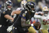 Baltimore Ravens quarterback Lamar Jackson (8) looks to pass the ball in the first half of an NFL football game against the San Francisco 49ers, Sunday, Dec. 1, 2019, in Baltimore, Md. (AP Photo/Nick Wass)