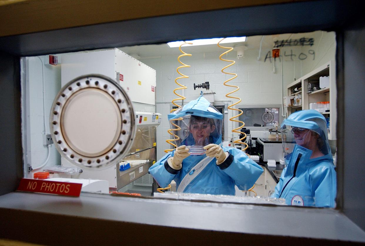 Researchers at work in the Biosafety Level 4 laboratory at the U.S. Army Medical Research Institute of Infectious Diseases at Fort Detrick in 2002.
