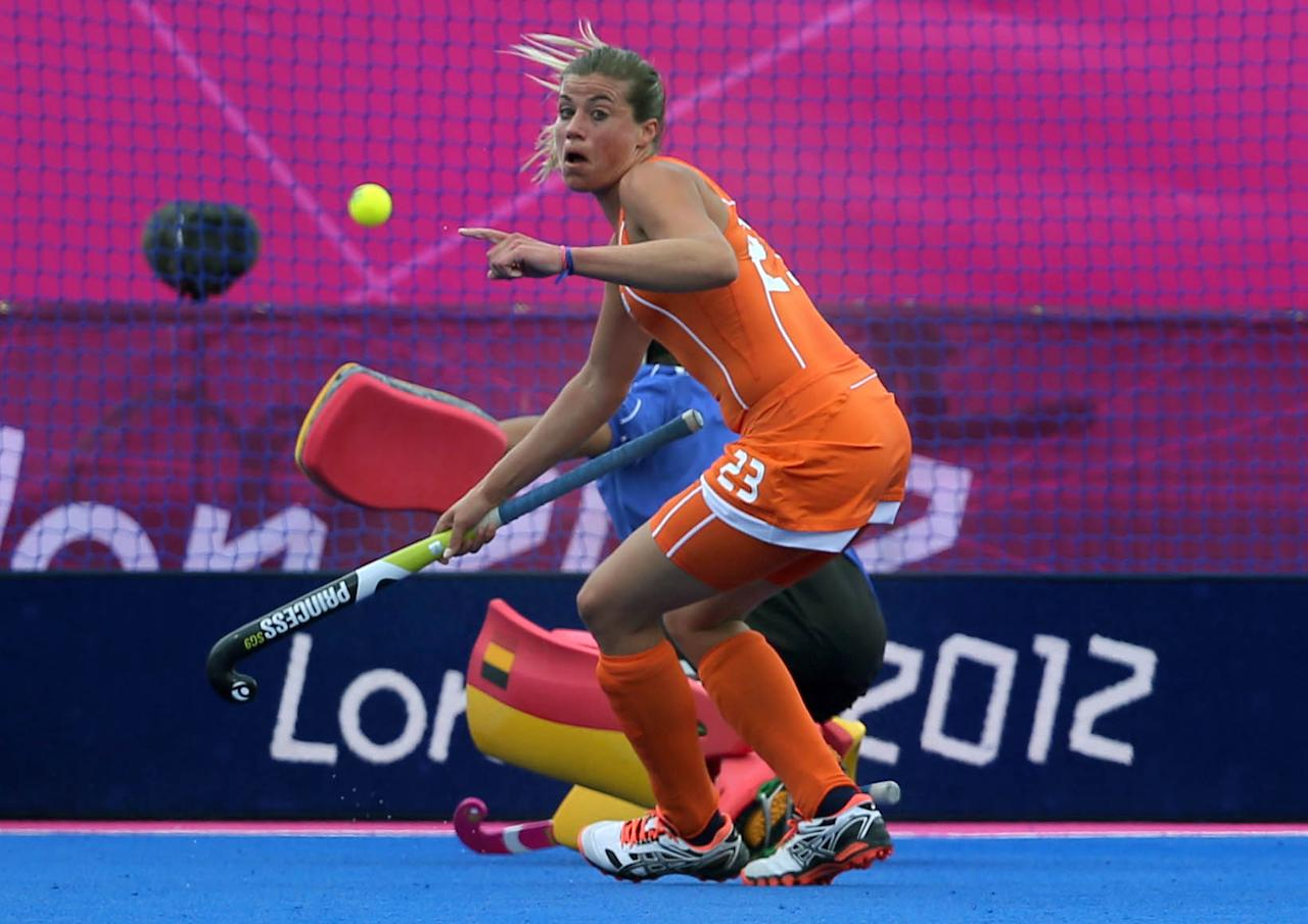 Netherlands Kim Lammers celebrates after scoring a goal during a women's hockey competition preliminary round match against Belgium at the 2012 Summer Olympics, Sunday, July 29, 2012, in London. (AP Photo/Eranga Jayawardena)