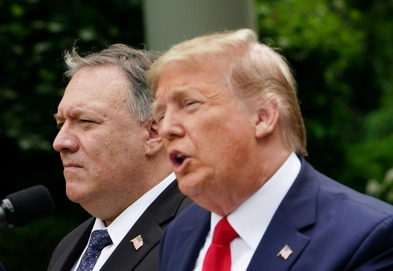 US President Donald Trump, with US Secretary of State Mike Pompeo, holds a press conference on China in the White House Rose Garden (AFP Photo/MANDEL NGAN)