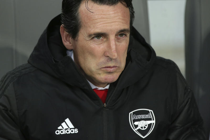 Arsenal's head coach Unai Emery sits on the bench during the Europa League group F soccer match between Vitoria SC and Arsenal at the D. Afonso Henriques stadium in Guimaraes, Portugal, Wednesday, Nov. 6, 2019. (AP Photo/Luis Vieira)