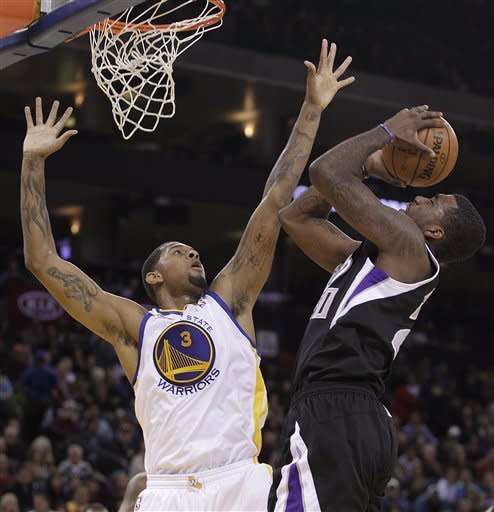 Sacramento Kings' Donte Greene, right, shoots against Golden State Warriors' Jeremy Tyler (3) during the first half of an NBA basketball game Saturday, March 24, 2012, in Oakland, Calif. (AP Photo/Ben Margot)