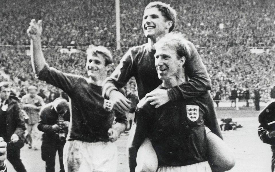 Roger Hunt celebrates the 1966 World Cup triumph while Alan Ball is carried on the shoulders of Jack Charlton - Getty Images
