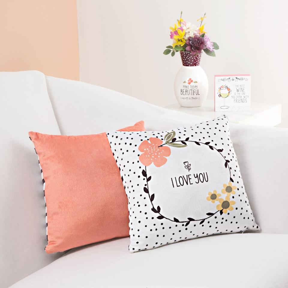 """<p>This <a rel=""""nofollow"""" href=""""https://www.popsugar.com/buy/Floral%20Love%20Pillow-404515?p_name=Floral%20Love%20Pillow&retailer=pier1.com&price=15&evar1=moms%3Aus&evar9=45663736&evar98=https%3A%2F%2Fwww.popsugar.com%2Fmoms%2Fphoto-gallery%2F45663736%2Fimage%2F45664022%2FFloral-Love-Pillow&list1=shopping%2Cvalentines%20day%2Cdecor%20shopping%2Cpier%201%20imports&prop13=mobile&pdata=1"""" rel=""""nofollow"""">Floral Love Pillow</a> ($15) is a cute present for your SO.</p>"""