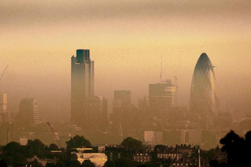 Mist and pollution hang over Tower 42 (centre) and St Mary's Axe (right) in the City of London: Matthew Fearn/PA