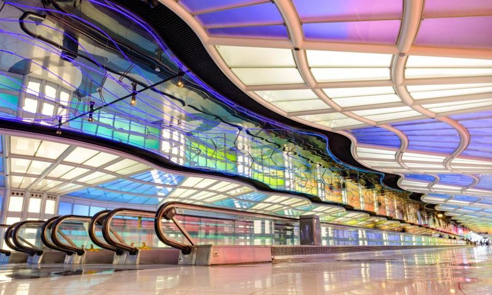 Helmut Jahn's tunnel passageway of the United Airlines terminal at Chicago's O'Hare airport, 1988, designed in collaboration with the Canadian neon artist Michael Hayden.