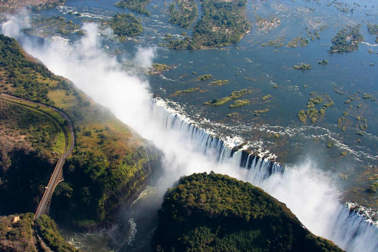 """A scenic aerial adventure is the best way to capture the essence of the world's largest waterfall. The ride is also known as the <a rel=""""nofollow"""" href=""""http://www.shearwatervictoriafalls.com/activities/flight-angels/"""">""""Flight of Angels,""""</a> proving you're destined to see something miraculous."""