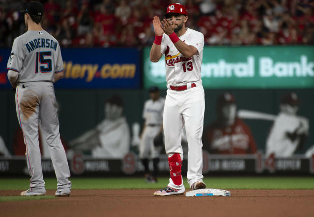 The Cardinals' Matt Carpenter celebrates a bunt double during the fifth inning against the Miami Marlins. (AP Photo/L.G. Patterson)