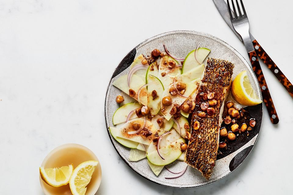 """Perfect crisped skin and a nutty pan sauce make fish feel downright luxurious. For even more flavor, toast a handful of nuts in a skillet with a few tablespoons of olive oil or butter until they're super golden and fragrant. <a href=""""https://www.epicurious.com/recipes/food/views/crispy-fish-with-brown-butter-sauce-and-kohlrabi-salad?mbid=synd_yahoo_rss"""" rel=""""nofollow noopener"""" target=""""_blank"""" data-ylk=""""slk:See recipe."""" class=""""link rapid-noclick-resp"""">See recipe.</a>"""