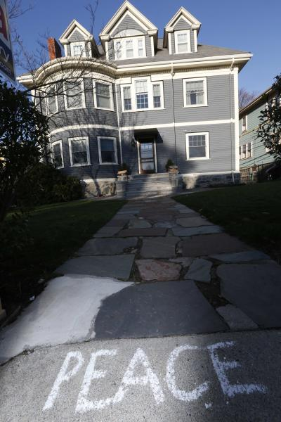 Peace is written on the sidewalk in front of the Richard house in the Dorchester neighborhood of Boston, Tuesday, April 16, 2013. Martin Richard, 8, was killed in Monday's bombing at the finish line of the Boston Marathon. (AP Photo/Michael Dwyer)