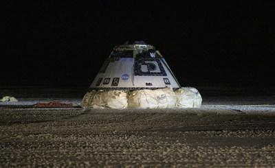 The Boeing CST-100 Starliner spacecraft is seen after it landed in White Sands, New Mexico, Sunday, Dec. 22, 2019. The landing completes an abbreviated Orbital Flight Test for the company that still meets several mission objectives for NASA's Commercial Crew program. Credit: (NASA/Bill Ingalls)