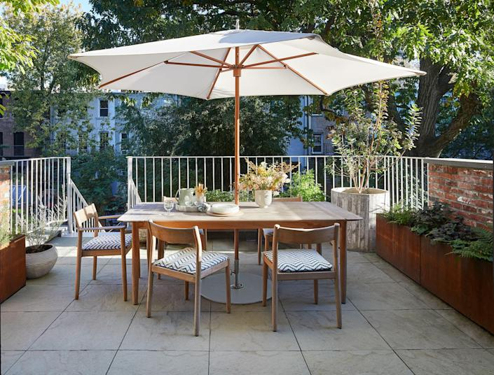 The dining set and umbrella are from Design Within Reach.
