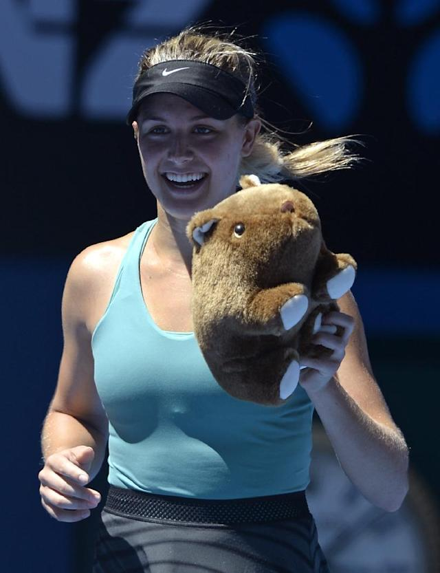 Eugenie Bouchard of Canada, holding stuffed animal of wombat, celebrates after defeating Ana Ivanovic of Serbia during their quarterfinal at the Australian Open tennis championship in Melbourne, Australia, Tuesday, Jan. 21, 2014. (AP Photo/Andrew Brownbill)