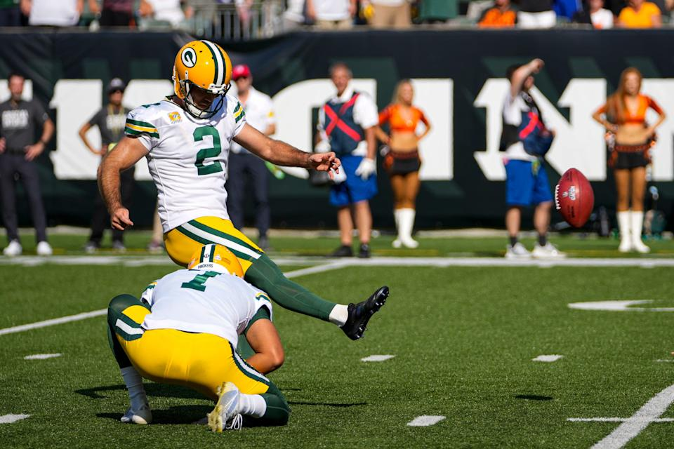 Green Bay Packers kicker Mason Crosby (2) kicks a field goal from he hold of Corey Bojorquez in the second half of an NFL football game against the Cincinnati Bengals in Cincinnati, Sunday, Oct. 10, 2021.