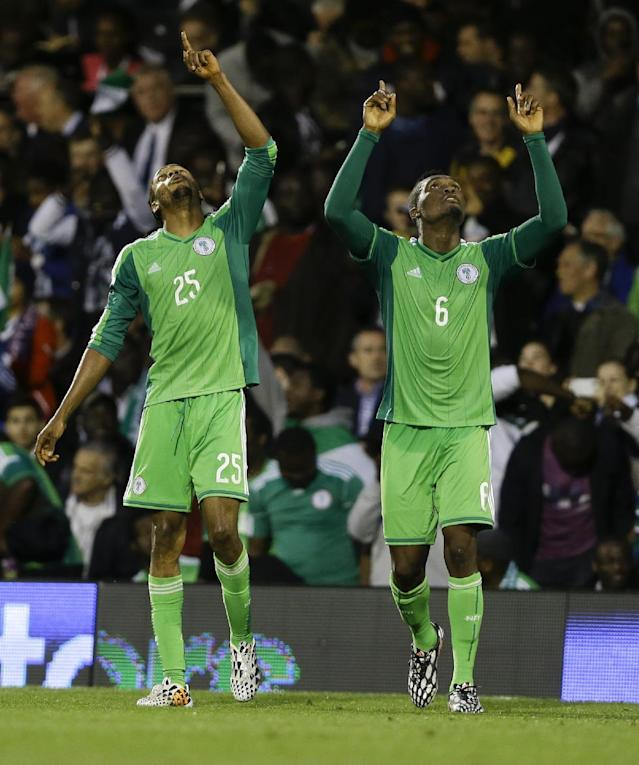 Nigeria's Michael Uchebo, left, celebrates with Azubuike Egwueke after he scores a goal during the international friendly soccer match between Nigeria and Scotland at Craven Cottage Stadium in London, Wednesday, May 28, 2014. Nigeria will be in Group F in the upcoming World Cup in Brazil. (AP Photo/Kirsty Wigglesworth)
