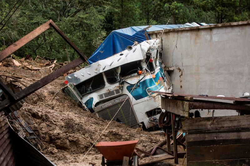 The wreckage of a trailer is seen at an area hit by a mudslide, caused by heavy rains brought by Storm Eta, as the search for victims continue in the buried village of Queja