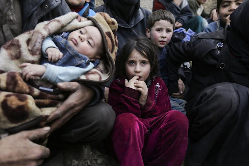 Syrian children wait to be evacuated from the eastern Ghouta enclave on the outskirts of Damascus on March 15, 2018.  (LOUAI BESHARA/Getty Images)