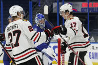 Chicago Blackhawks center Dylan Strome (17) celebrates with defenseman Adam Boqvist (27) after Strome scored against the Tampa Bay Lightning during the third period of an NHL hockey game Wednesday, Jan. 13, 2021, in Tampa, Fla. (AP Photo/Chris O'Meara)