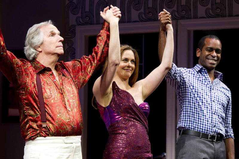 "Henry Winkler, left, Alicia Silverstone, center, and Daniel Breaker appear on stage at the curtain call for the opening night performance of the Broadway play, ""The Performers,"" on Wednesday, Nov. 14, 2012, in New York. (Photo by Charles Sykes/Invision/AP)"