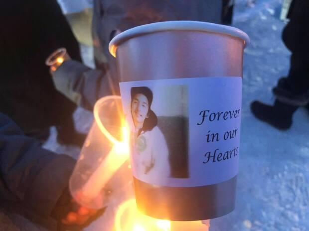 Sheshatshiu held a candlelight vigil Tuesday for Matthew Malleck, who died after being struck by an ATV on the weekend. (Submitted by Angie Tshakapesh - image credit)