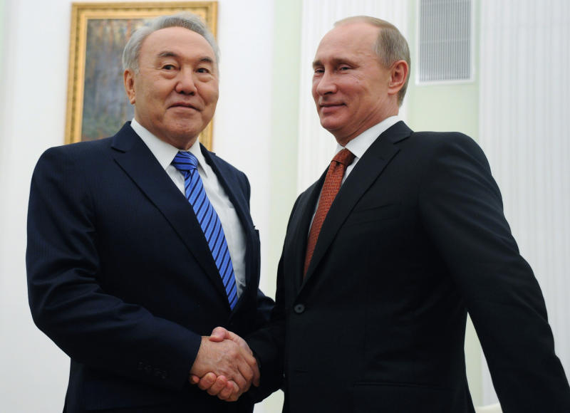 FILE - In this Feb. 8, 2013, file photo, Russian President Vladimir Putin, right, and Kazakhstan's President Nursultan Nazarbayev shake hands during their meeting in the Kremlin in Moscow. Nazarbayev, the only leader that independent Kazakhstan has ever known, abruptly announced his resignation Tuesday, March 19, 2019, after three decades in power. (Alexander Nemenov/Pool Photo via AP, File)