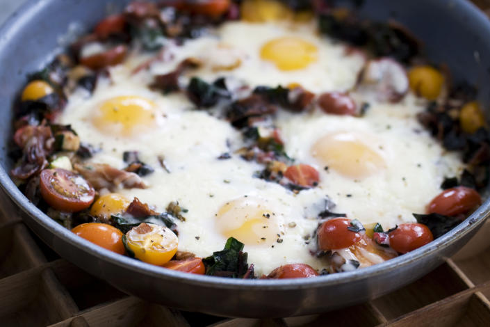 In this image taken on April 15, 20133, skillet garden eggs with fontina are shown in Concord, N.H. (AP Photo/Matthew Mead)