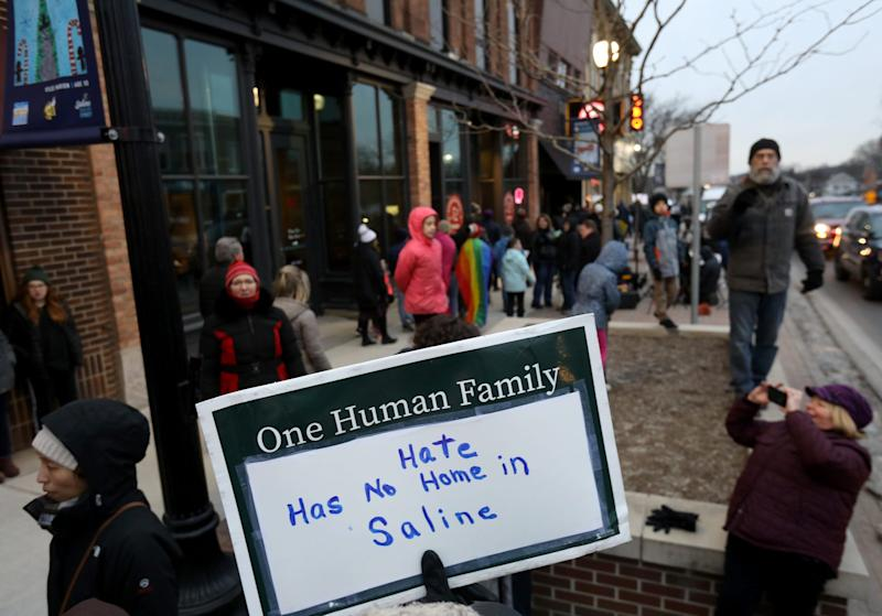 People marched with a variety of signs against racism and bigotry during a rally up and down on Michigan Avenue in downtown Saline, Michigan on Wednesday, February 5, 2020. The city and the school made national news on Monday when at a parent meeting on diversity and inclusion, racist language was used from one parent to another.