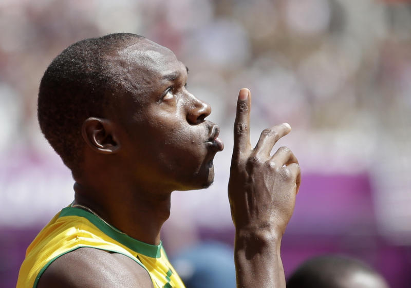 Jamaica's Usain Bolt gestures before competing in a men's 100-meter heat during the athletics in the Olympic Stadium at the 2012 Summer Olympics, London, Saturday, Aug. 4, 2012. (AP Photo/Matt Slocum)