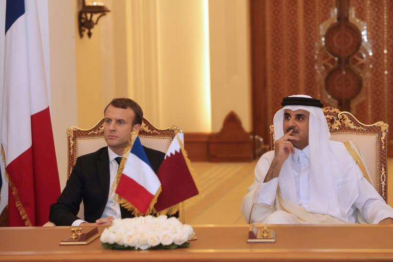 French President Emmanuel Macron and Qatari Emir Sheikh Tamim bin Hamad al-Thani oversee the signing of bilateral agreements in Doha on December 7, 2017