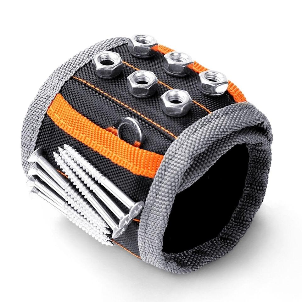 <p>If he loves hanging in the garage and is always working on projects, get him this <span>Horusdy Magnetic Wristband</span> ($10).</p>