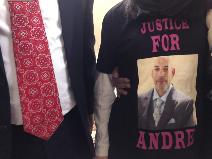 FILE - Andre Hill, fatally shot by Columbus police on Dec. 22, is memorialized on a shirt worn by his daughter, Karissa Hill, on Thursday, Dec. 31, 2020, in Columbus, Ohio. Ohio's capital city will pay a $10 million settlement for the family of Hill, a Black man who was fatally shot by a white Columbus police officer in December as he emerged from a garage holding a cellphone, the Columbus city attorney announced Friday, May 14, 2021. (AP Photo/Andrew Welsh-Huggins, File)