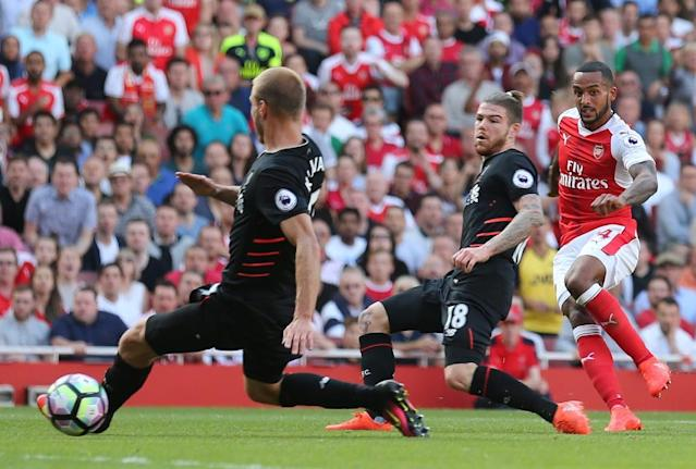 Arsenal's midfielder Theo Walcott (R) scores at the Emirates Stadium in London on August 14, 2016 (AFP Photo/Lee Mills)