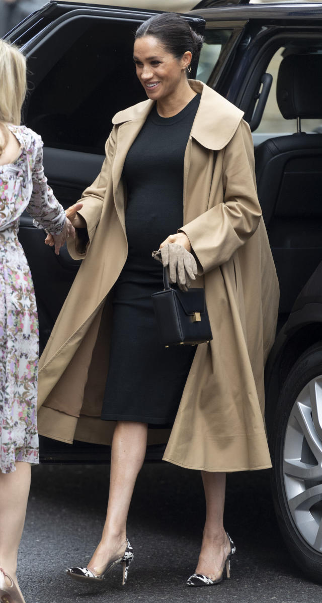 For a visit to one of her first patronages, Smart Works, the mother-to-be stepped out of her regal comfort zone in a chic £2,492 camel-hued Oscar de la Renta coat over a £170 black dress by US maternity label Hatch. But it was her bang-on-trend Gianvito Rossi cow print shoes which proved most surprising. <em>[Photo: Getty]</em>