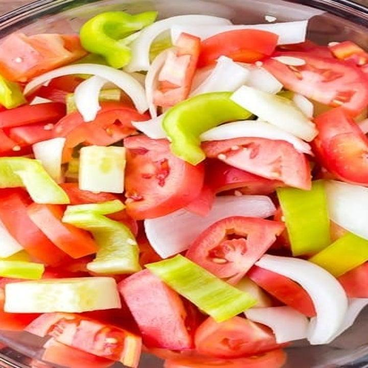 Tomatoes, pepper, and onion for gazpacho.