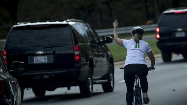 Virginia cyclist Juli Briskman gives the Trump motorcade the finger as it passes. (Photo: Getty Images)