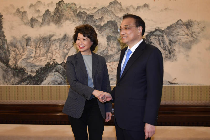 BEIJING, CHINA - APRIL 26: U.S. Secretary of Transportation Elaine Chao (L) shakes hands with Chinese Premier Li Keqiang before a meeting at the Zhongnanhai Leadership Compound on April 26, 2018 in Beijing, China. (Photo by Naohiko Hatta - Pool /Getty Images)