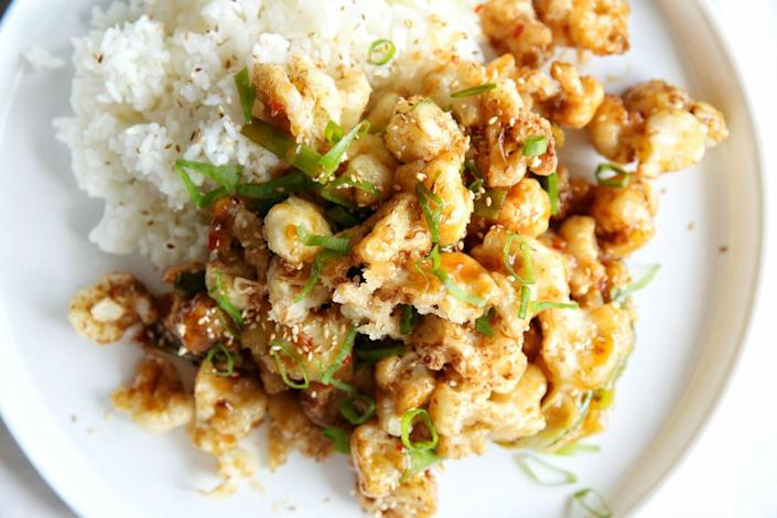 """<p>A vegetarian option that even carnivores will love!</p><p>Get the recipe from <a href=""""https://www.delish.com/cooking/recipe-ideas/recipes/a49459/general-tsos-cauliflower-with-rice-recipe/"""" rel=""""nofollow noopener"""" target=""""_blank"""" data-ylk=""""slk:Delish"""" class=""""link rapid-noclick-resp"""">Delish</a>.</p>"""