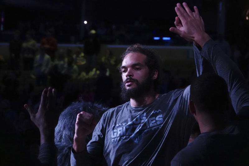 Memphis Grizzlies Joakim Noah (55) come onto the court before the first half of an NBA basketball game Friday, March 8, 2019, in Memphis, Tenn. (AP Photo/Karen Pulfer Focht)