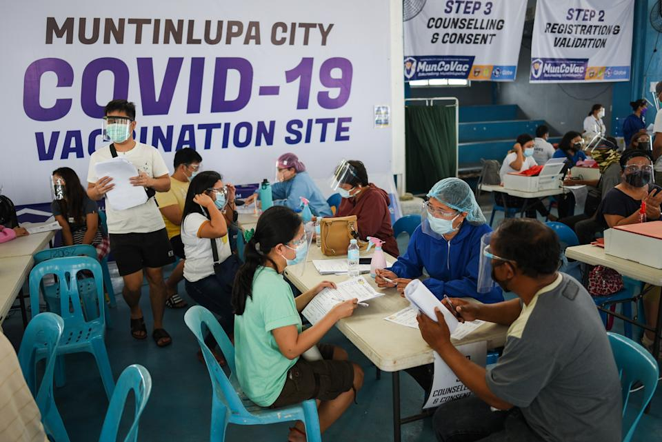 Residents undergo counseling before receiving their first dose of Sinovac Biotech's CoronaVac vaccine for the coronavirus disease (COVID-19), at the Barangay Sucat Covered Court, in Muntinlupa City, Metro Manila, Philippines, June 21, 2021. REUTERS/Lisa Marie David