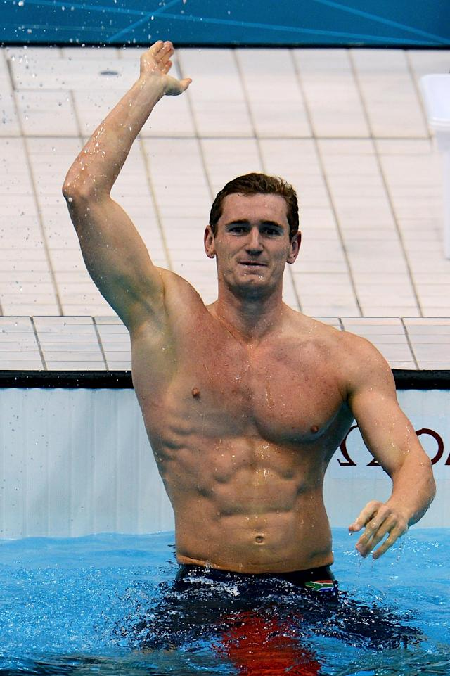 LONDON, ENGLAND - JULY 29: Cameron van der Burgh of South Africa celebrates after winning the gold in the Men's 100m Breastsroke final on Day 2 of the London 2012 Olympic Games at the Aquatics Centre on July 29, 2012 in London, England. (Photo by Mike Hewitt/Getty Images)