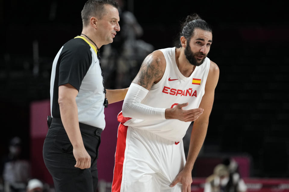 Spain's Ricky Rubio, right, questions a call during a men's basketball preliminary round game against Argentina at the 2020 Summer Olympics, Thursday, July 29, 2021, in Saitama, Japan. (AP Photo/Eric Gay)