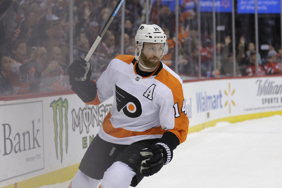 Philadelphia Flyers' Sean Couturier reacts after scoring during the shootout in the team's NHL hockey game against the New Jersey Devils in Newark, N.J., Friday, Nov. 1, 2019. The Flyers won 4-3. (AP Photo/Seth Wenig)