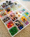 """<p>Though the under-the-bed idea is great for blocks, the super-tiny parts (like figures, flowers, and teeny blocks) require a different solution to keep from getting lost.</p><p><a href=""""http://childhood101.com/2014/01/lego-organisation-ideas/"""" rel=""""nofollow noopener"""" target=""""_blank"""" data-ylk=""""slk:See more at Childhood 101 »"""" class=""""link rapid-noclick-resp""""><em>See more at Childhood 101 »</em></a></p>"""