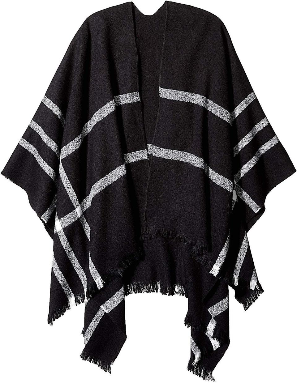 """<p>This <a href=""""https://www.popsugar.com/buy/Orchid-Row-Knit-Scarf-Poncho-505271?p_name=Orchid%20Row%20Knit%20Scarf%20Poncho&retailer=amazon.com&pid=505271&price=26&evar1=fab%3Auk&evar9=46947746&evar98=https%3A%2F%2Fwww.popsugar.com%2Ffashion%2Fphoto-gallery%2F46947746%2Fimage%2F46949404%2FOrchid-Row-Knit-Scarf-Poncho&list1=shopping%2Camazon%2Choliday%2Choliday%20fashion%2Cfashion%20shopping&prop13=api&pdata=1"""" rel=""""nofollow noopener"""" class=""""link rapid-noclick-resp"""" target=""""_blank"""" data-ylk=""""slk:Orchid Row Knit Scarf Poncho"""">Orchid Row Knit Scarf Poncho</a> ($26) looks great over a long-sleeved shirt.</p>"""
