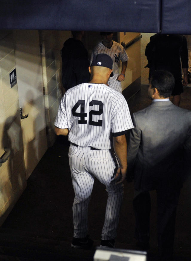 New York Yankees closer Mariano Rivera goes into the tunnel leading to the clubhouse after the Tampa Bay Rays defeated the Yankees, 4-0, in a baseball game Thursday, Sept. 26, 2013, at Yankee Stadium in New York. It was Rivera's final home game before his retirement. (AP Photo/Bill Kostroun)