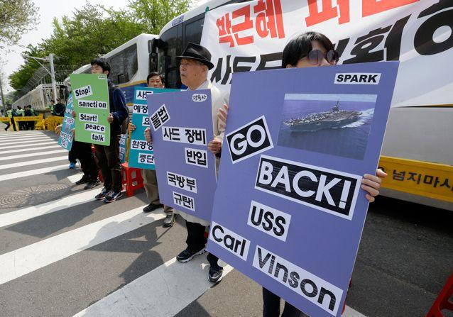 South Korean protesters stage a rally against US deployment of the USS Carl Vinson aircraft carrier and its battle group to the Korean Peninsula. Source: AP
